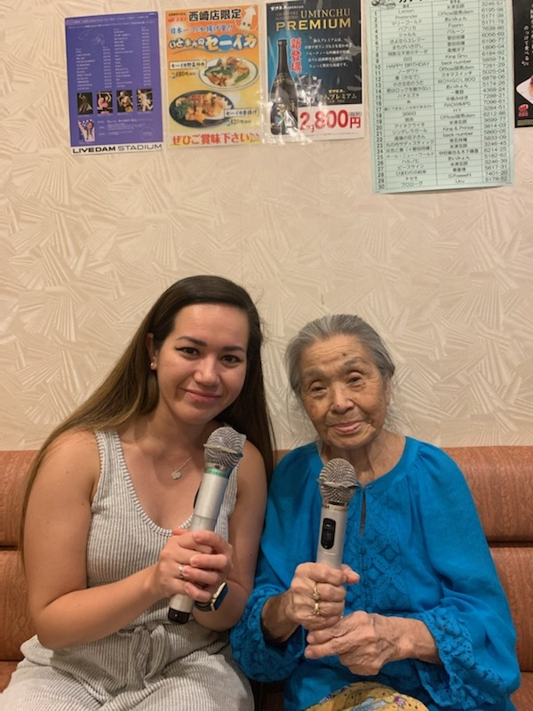 Ashley and her grandmother during karaoke