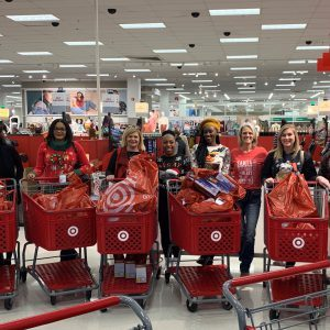 Inflight Leadership Team Shopping for Toys for Tots Drive