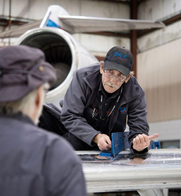 Mechanics communicating on the job