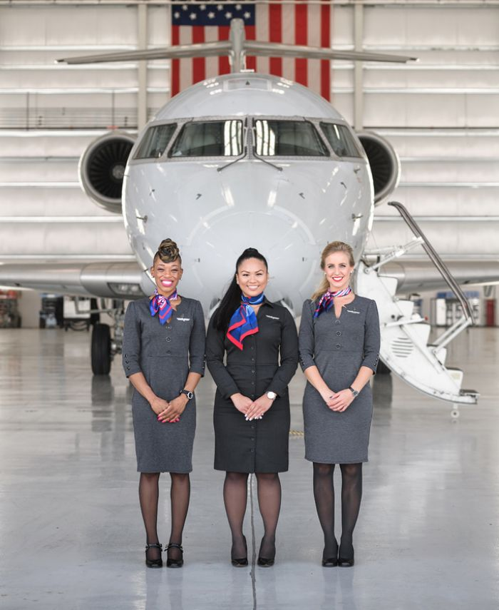 Flight Attendants standing in front of an American Airlines plane.