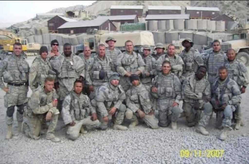 Patrick O'Keefe (back, row, center) and his division while on deployment in Afghanistan
