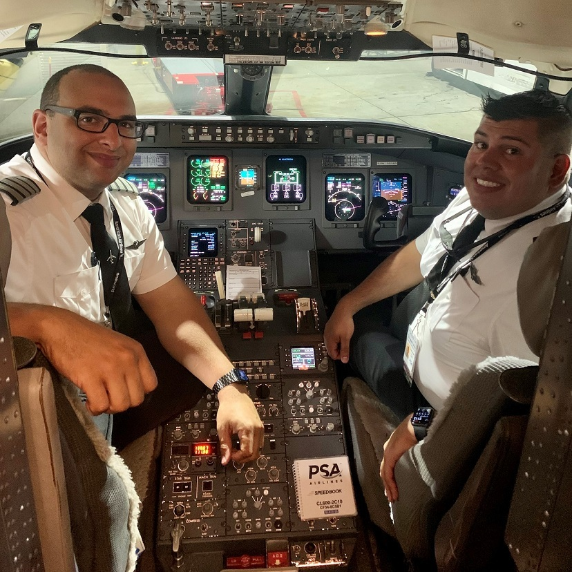 Ted Fosselman (right) and LCA Daris Towson smiling in cockpit following a trip from CLT to CRW